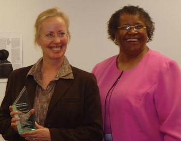 Cara being awarded Outstanding Service Award in 2007 by Dr. Berry of Howard University