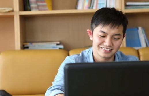 Asian man at work